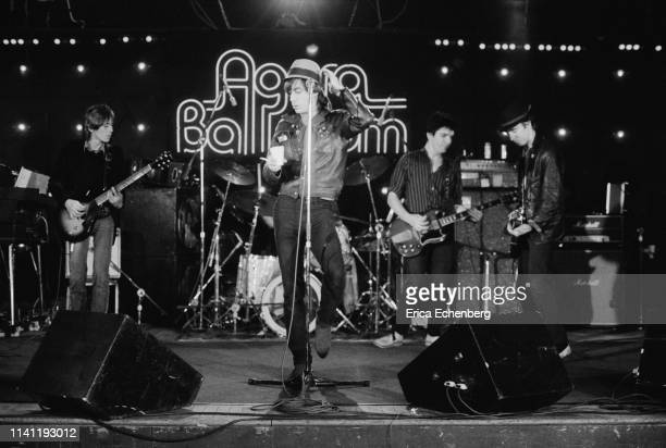 Iggy Pop performs on stage at the Agora Ballroom Cleveland Ohio United States on his New Values Tour November 13th 1979 LR Ivan Kral Iggy Pop Brian...