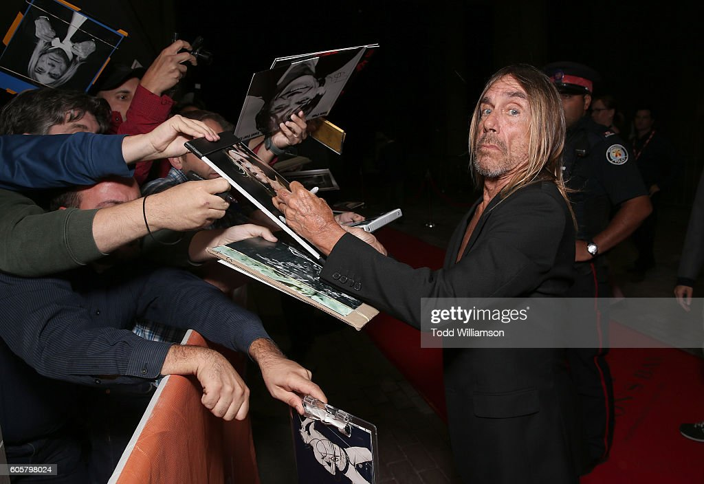 Iggy Pop signs autographs at the Premiere of Amazon Studios' 'Gimme Danger' at the Toronto International Film Festival at Ryerson Theatre on September 14, 2016 in Toronto, Canada.