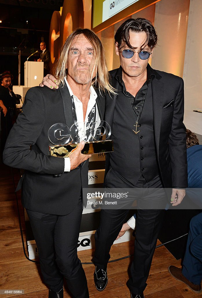 Iggy Pop (L), winner of the Icon Award, and presenter Johnny Depp attend the GQ Men Of The Year awards in association with Hugo Boss at The Royal Opera House on September 2, 2014 in London, England.