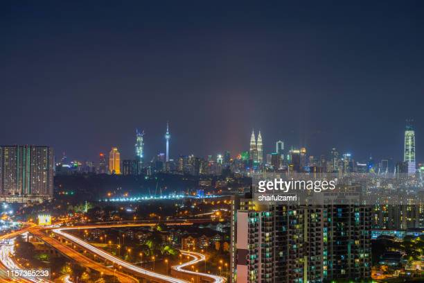 ight view over downtown kuala lumpur (kl). kl is the capital of malaysia. - shaifulzamri stock pictures, royalty-free photos & images