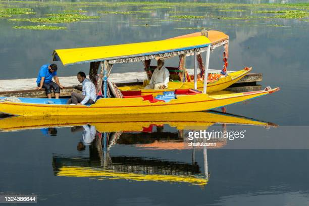 ightseeing over dal lake using a shikara - a type of wooden boat. - shaifulzamri stock pictures, royalty-free photos & images