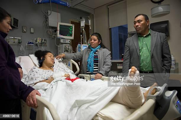 Iglesia Minister de Dios Unido church pastor Jose Angel Santos and his wife Oneida Santos Jimenez visit Sandra Gomez in the ICU at The Washington...