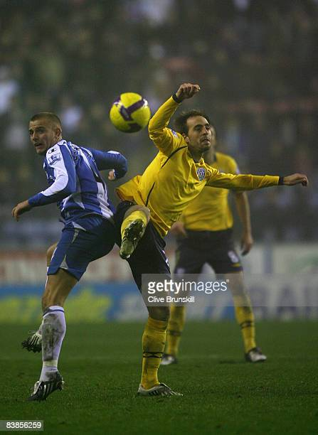 Iglesias Borja Valero of West Bromwich Albion in action with Lee Cattermole of Wigan during the Barclays Premier League match between Wigan Athletic...