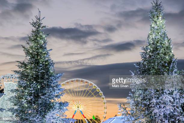 igloo and ferris wheel between two trees in dusk in nice - between stock pictures, royalty-free photos & images