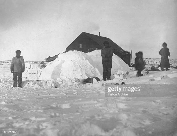 Igloos built by the indigenous members of the team outside the headquarters near Point Barrow Alaska during the Canadian Arctic Expedition 18th March...