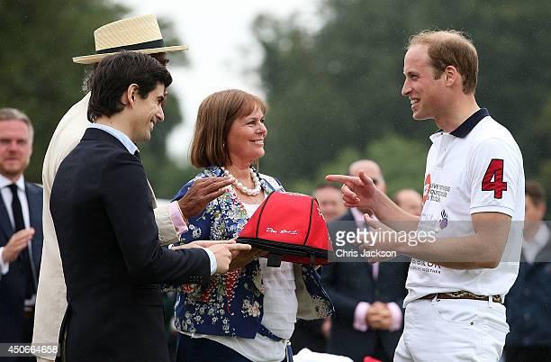 Ignacio Archain Kuldip Singh Dhillon Chariman of Cirencester Park Polo Club and Gachi Ferrari present Prince William Duke of Cambridge with the La...