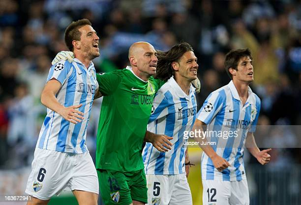 Ignacio Camacho goalkeeper Willy Caballero Martin Demichelis and Lucas Piazon of Malaga CF celebrate at the end of the UEFA Champions League Round of...