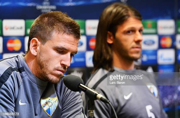 Ignacio Camacho looks on next to team mate MArtin Demichelis during a Malaga CF press conference ahead of their UEFA Champions League quarterfinal...