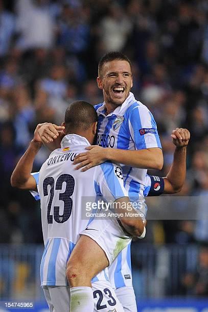 Ignacio Camacho of Malaga CF celebrates their victory with teammate Oguchi Onyewu after the UEFA Champions League group C match between Malaga CF and...