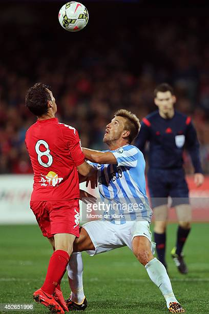 Ignacio Camacho of Malaga competes with Isaias Sanchez of Adelaide during the international club friendly match between Adelaide United and Malaga CF...