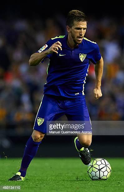 Ignacio Camacho of Malaga runs with the ball during the La Liga match between Valencia CF and Malaga CF at Estadi de Mestalla on October 17 2015 in...