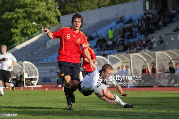 Ignacio Camacho of Spain battles for the ball with Konstantin Rausch of Germany during the U19 Euro Qualifier match between Spain and Germany at the...