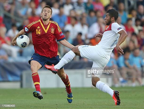 Ignacio Camacho of Spain challenges Tonny Trindade De Vilhena of the Netherlands during the UEFA European U21 Championships Group B match between...