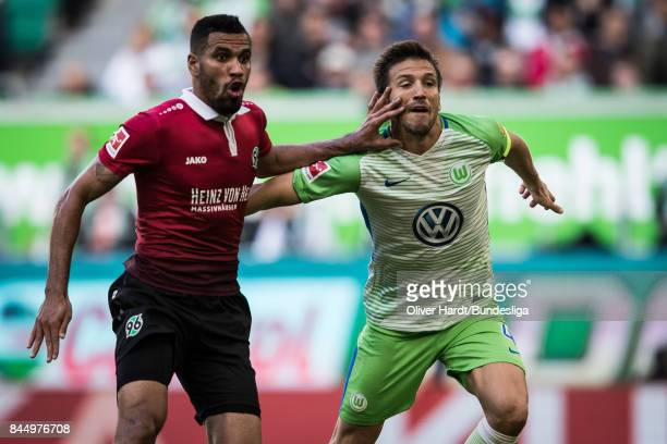 Ignacio Camacho of Wolfsburg and Felipe of Hannover compete for the ball during the Bundesliga match between VfL Wolfsburg and Hannover 96 at...