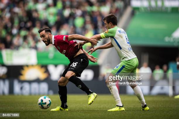 Ignacio Camacho of Wolfsburg and Kenan Karaman of Hannover compete for the ball during the Bundesliga match between VfL Wolfsburg and Hannover 96 at...
