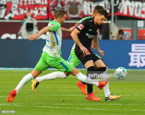 Ignacio Camacho of Wolfsburg and Lucas Nicolas Alario of Leverkusen battle for the ball during the Bundesliga match between Bayer 04 Leverkusen and...