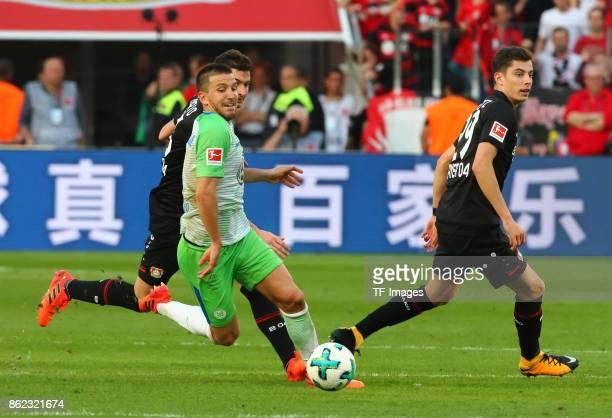 Ignacio Camacho of Wolfsburg and Lucas Nicolas Alario of Leverkusen and Kai Havertz of Leverkusen battle for the ball during the Bundesliga match...