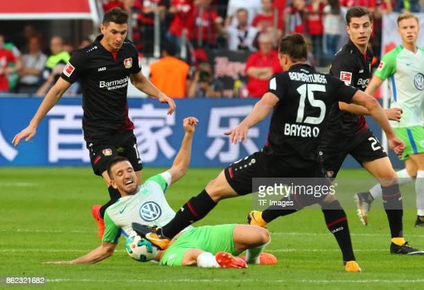 Ignacio Camacho of Wolfsburg and Lucas Nicolas Alario of Leverkusen and Julian Baumgartlinger of Leverkusen battle for the ball during the Bundesliga...