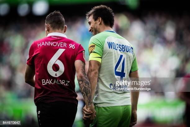 Ignacio Camacho of Wolfsburg and Marvin Bakalorz of Hannover compete for the ball during the Bundesliga match between VfL Wolfsburg and Hannover 96...