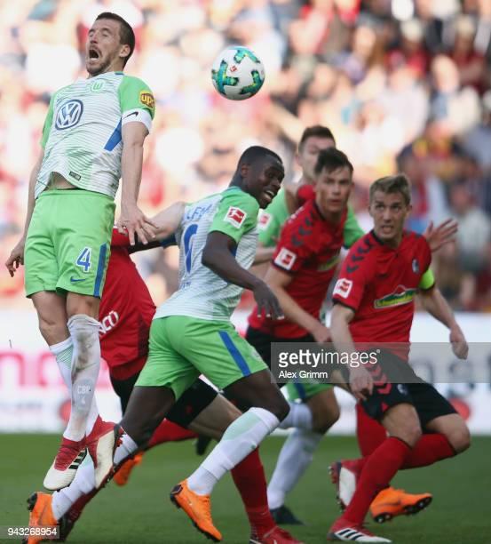 Ignacio Camacho of Wolfsburg jumps for the ball during the Bundesliga match between Sport-Club Freiburg and VfL Wolfsburg at Schwarzwald-Stadion on...