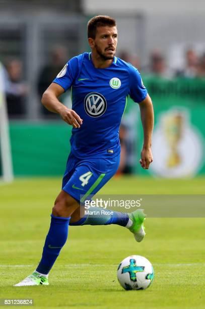 Ignacio Camacho of Wolfsburg runs with the ball during the DFB Cup first round match between FC Eintracht Norderstedt and VfL Wolfsburg at...