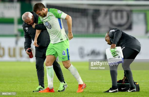 Ignacio Camacho of Wolfsburg walks injured off the pitch during the DFB Cup match between VfL Wolfsburg and Hannover 96 at Volkswagen Arena on...