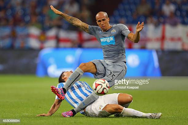 Ignacio Camcho of Malaga challenges Gabriel Obertan of Newcastle United during the match between FC Malaga and Newcastle United as part of the...