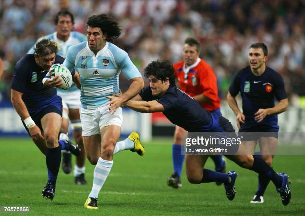 Ignacio Corleto of Argentina makes a break during the opening match of the Rugby World Cup 2007 between France and Argentina at the Stade de France...