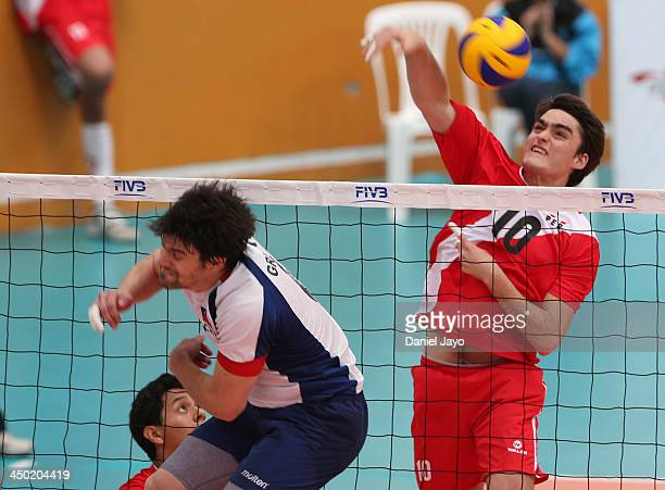 Ignacio Correa of Peru competes during a match against Chile in Volleyball event as part of the XVII Bolivarian Games Trujillo 2013 at Gran Chimœu...
