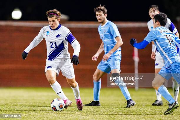 Ignacio Cubeddu of Amherst Mammoths runs with the ball during the Division III Men's Soccer Championship held at UNCG Soccer Stadium on December 7...