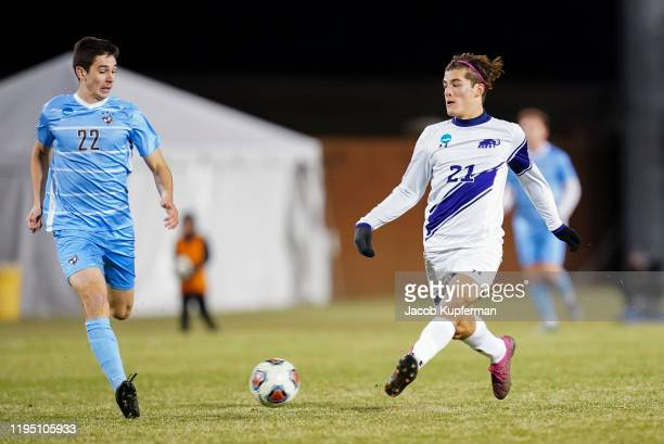 Ignacio Cubeddu of the Amherst Mammoths is guarded by Aidan Welsh of the Tufts Jumbos during the Division III Men's Soccer Championship held at UNCG...