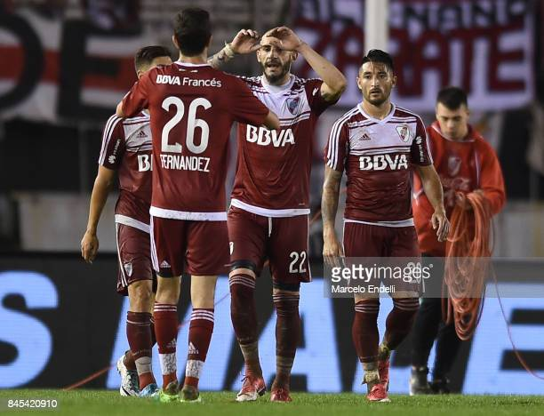Ignacio Fernandez and Javier Pinola of River Plate celebrate after winning a match between River Plate and Banfield as part of Superliga 2017/18 at...