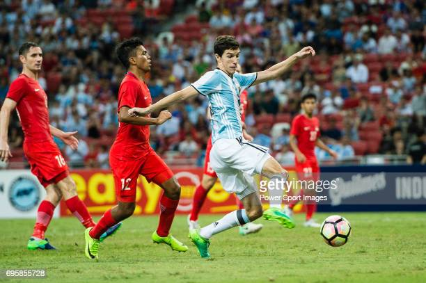 Ignacio Fernandez of Argentina in action against Sariful Sulaiman of Singapore during the International Test match between Argentina and Singapore at...