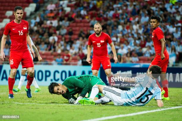 Ignacio Fernandez of Argentina trips up with Izwan Mahbud of Singapore during the International Test match between Argentina and Singapore at...