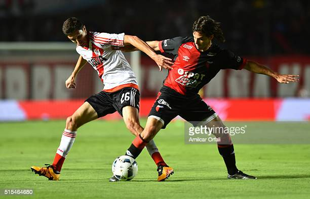 Ignacio Fernandez of River Plate and Diego Lagos of Colon fight for the ball during a match between Colon and River Plate as part of Torneo de...