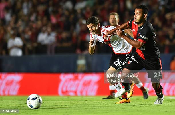 Ignacio Fernandez of River Plate and Ismael Benegas Arevalos of Colon fight for the ball during a match between Colon and River Plate as part of...