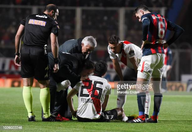 Ignacio Fernandez of River Plate being injured during a match between San Lorenzo and River Plate as part of Superliga Argentina 2018/19 at Estadio...