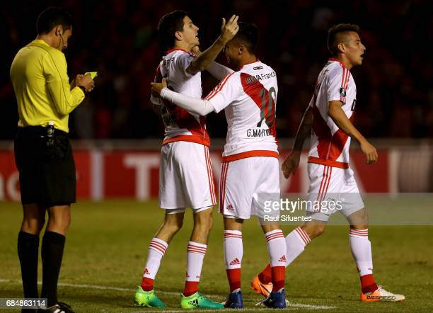Ignacio Fernandez of River Plate celebrates with Gonzalo Martinez after scoring the third goal of his team during a group stage match between FBC...