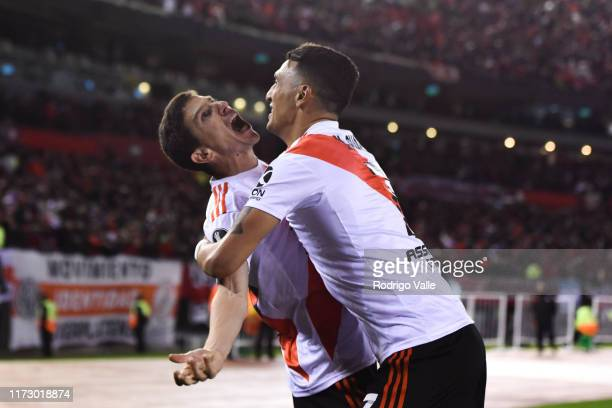 Ignacio Fernandez of River Plate celebrates with teammate Matias Suarez after scoring the second goal of his team during the semi final first leg...
