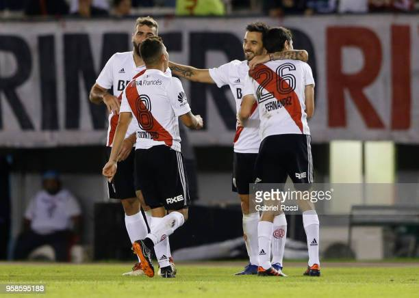 Ignacio Fernandez of River Plate celebrates with teammates Ignacio Scocco and Lucas Patto after scoring the opening goal during a match between River...