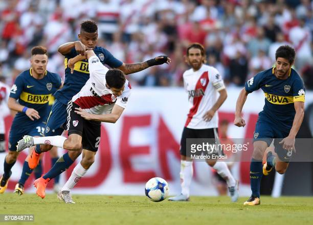 Ignacio Fernandez of River Plate fights for ball with Wilmar Barrios of Boca Juniors during a match between River Plate and Boca Juniors as part of...