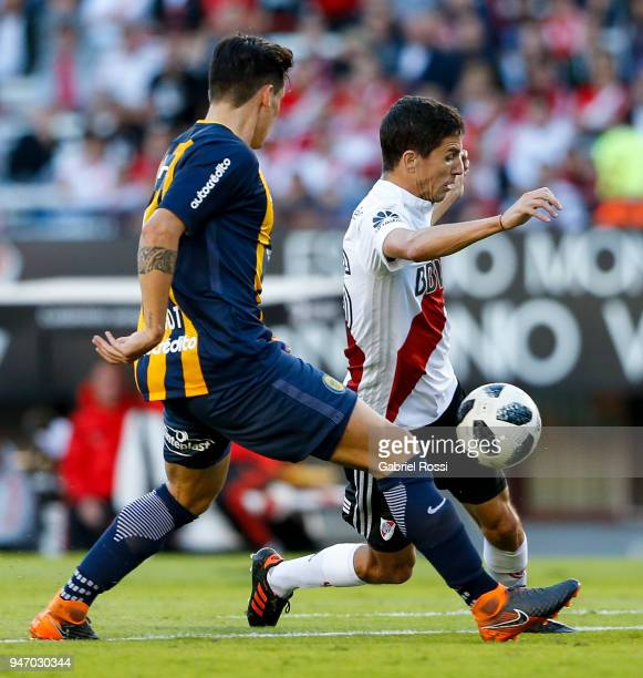 Ignacio Fernandez of River Plate fights for the ball with Alfonso Parot Rojas of Rosario Central during a match between River Plate and Rosario...