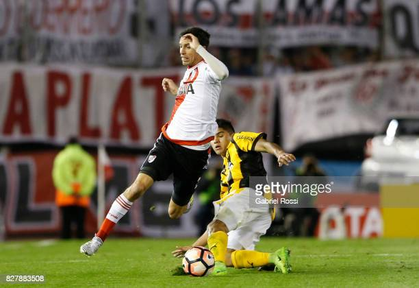 Ignacio Fernandez of River Plate fights for the ball with Antonio Marin of Guarani during a second leg match between River Plate and Guarani as part...