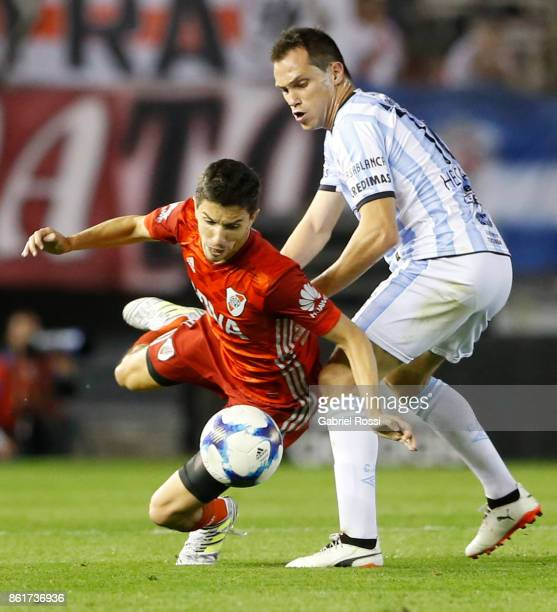 Ignacio Fernandez of River Plate fights for the ball with Hernan Hechalar of Atletico de Tucuman during a match between River Plate and Atletico de...