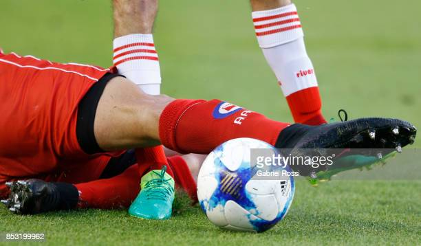 Ignacio Fernandez of River Plate fights for the ball with Joaquin Laso of Argentinos Juniors during a match between River Plate and Argentinos...