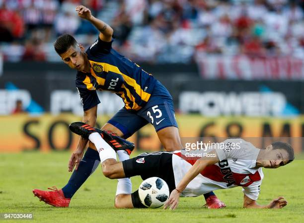 Ignacio Fernandez of River Plate fights for the ball with Joaquin Pereyra of Rosario Central during a match between River Plate and Rosario Central...