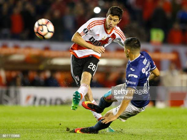 Ignacio Fernandez of River Plate fights for the ball with Jorge Antonio Ortiz of Wilstermann during a second leg match between River Plate and...