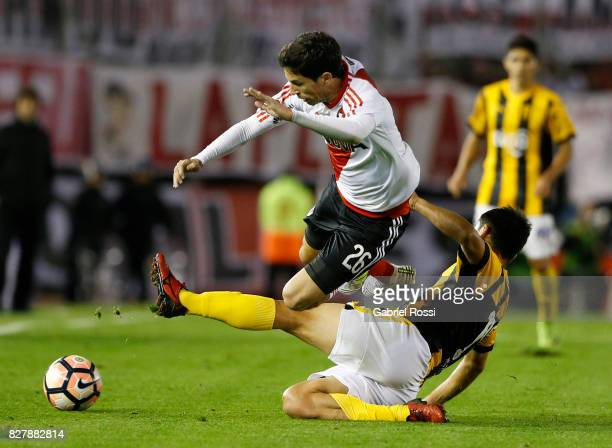 Ignacio Fernandez of River Plate fights for the ball with Tomas Bartomeus of Guarani during a second leg match between River Plate and Guarani as...
