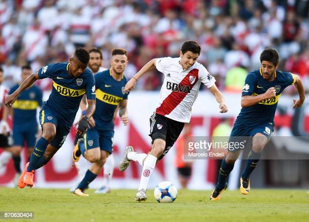 Ignacio Fernandez of River Plate fights for the ball with Wilmar Barrios and Pablo Perez of Boca Juniors during a match between River Plate and Boca...