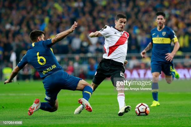 Ignacio Fernandez of River Plate is challenged by Lisandro Magallan of Boca Juniors during the second leg of the final match of Copa CONMEBOL...